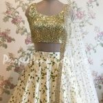 Off White Floral Raw Silk Lehenga with Heavy Sequins Choli