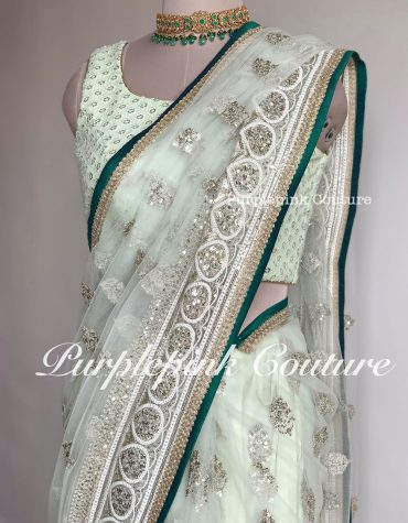 Intricate Zari Sequins Work Net Saree
