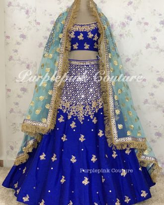 Royal Blue Raw Silk Complete Hand Mirror Embroidered Lehenga Choli Net Blue Zhalar Dupatta