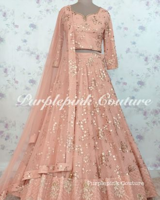 Pale Peach Net Sequins Embroidered Lehenga Choli