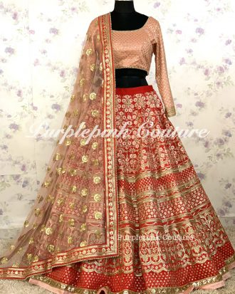 Red Raw Silk Heavy Embroidered Lehenga Pink Silk Blouse Net Dupatta