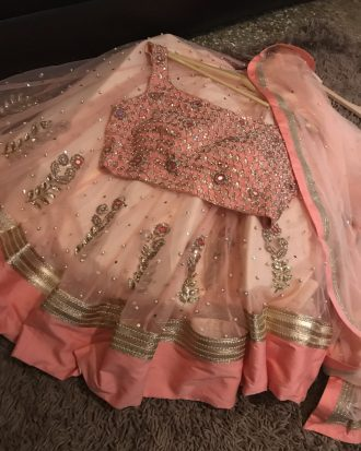 Pinkish Peach Net Base Complete Hand Embroidered Lehenga Pink Choli